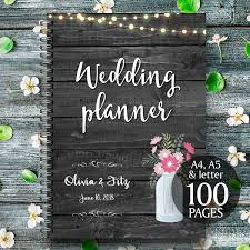 Printable Wedding Planner On Black Wood With Mason Jar With