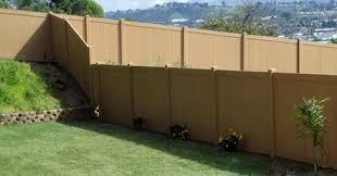 vinyl fencing. A Vinyl Fence Dividing Two Yards Fencing N