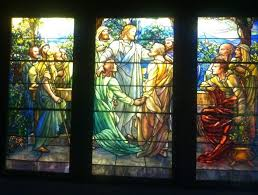 a stained glass window showing a religious scene
