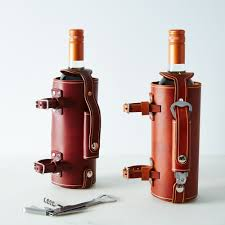 bicycle mounted leather wine bottle carrier bottle carrier unique gifts pedal happy food52 on food52
