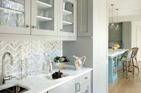 herringbone kitchen backsplash marble white