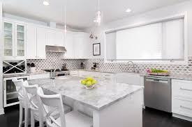 white kitchen cabinets with super white quartzite countertops