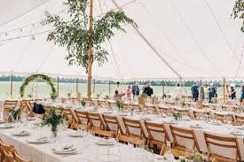trestle tables and wooden folding chairs benches for wedding ceremony