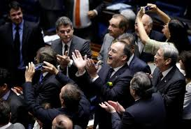 members of brazil s senate react after a vote to impeach president dilma rousseff for breaking