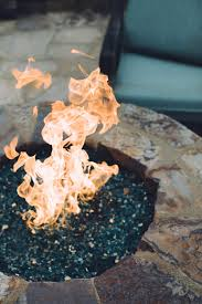 image of fire glass pebbles in a burning fire pit