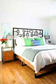 try this japanese inspired diy modern bed frame from modern builds the hair pin legs are perfection and that walnut stain on the headboard