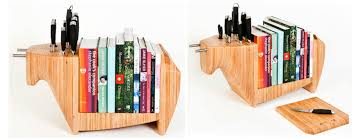the toro legno kitchen bull shown above is a fanciful item a knife block with 10 slots a book shelf and a cheese board for those with the necessary