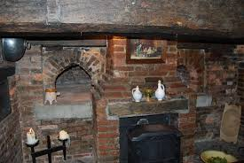 fireplaces the ashes from fire saved for cleaning purposes part fill a fireplace brick