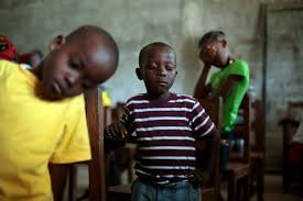 monrovia photographer covering ebola the world must see file in this sunday sept 28 2014 file photo children pray during