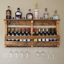 Beautiful rustic finish on reclaimed pallet wood wine rack. Exclusive  design easily mounts to your