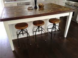 image of rustic reclaimed wood kitchen island with stools