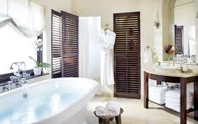 hotels with big bathtubs. Beige Bathroom With Tile Floor, Freestanding White Tub, Wood Vanity Vessel Link, Hotels Big Bathtubs