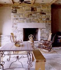 rustic home interior design with masonry fireplace and stone flooring ideas design