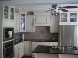 Dove White Kitchen Cabinets Whats The Better Off White Kraftmaid Canvas Or Biscotti