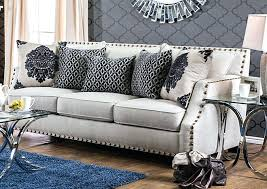 nailhead sofa beige trim w of leather sectional couch and loveseat tufted