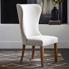 with its gently rounded side wings curved back legs and wide seat the albie wing dining chair is dressed up seating that lets you sit back and relax