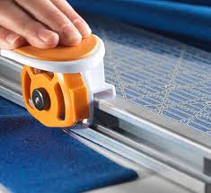 Rotary Fabric Cutters, Rotary Blades & Circle Cutters   Fiskars & Two great tools in one. Quickly measure and cut fabric ... Adamdwight.com