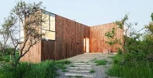 Minimalist timber CML House in Chile features a unique pinwheel layout