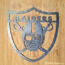 raiders metal sign on raiders metal wall art with raiders metal sign zug monster signs signage metal signs wood