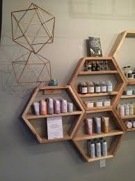 love the idea of displaying beauty products in the bathroom in these kind  of geometric shapes - so much nicer for bathroom storage!