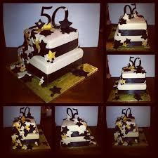 black fondant sheets 50th birthday cake ivory and black fondant black ribbon gold