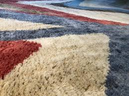 the wildly long fibers of rugs in hues such as day glo orange and electric blue suited the loosey goosey experimental 1960s and 70s