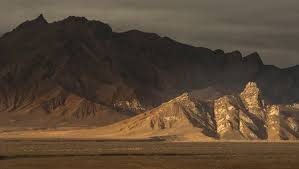 an essay on mountains the th dalai lama travelers in tibet traditionally add a stone to the cairns at the tops of hills or passes a shout of lha gyal io victory to the gods