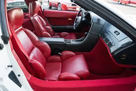 1990 c4 corvette with white exterior and bright red interior