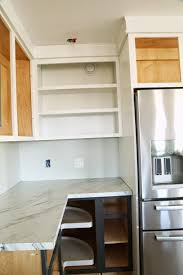 and we built an open wall cabinet on the other end of the wall cabinets the kitchen is more balanced with the two open wall cabinets on each end