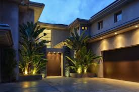 luxury home lighting. modren home exterior natural banana tree on square planter closed cute uplight near  brown door plus glass for luxury home lighting 0
