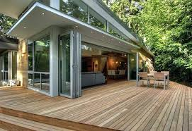 large sliding glass doors folding patio stacked against each other leading to deck with outdoor dining