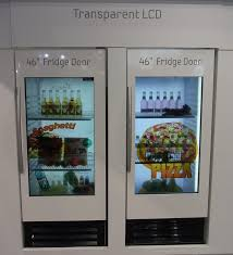 samsung s 46 inch lcd panels mounted on the glass doors of refrigerators