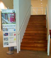 clip banner stand used in library as directional signage