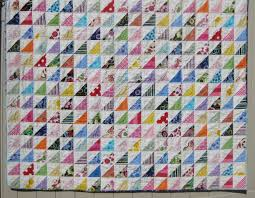 Half Square Triangle quilt complete | Squares and Triangles & Using my stash, made over 400 half square triangles. I sewed them first  into rows of 18, and then pieced 22 rows together. Adamdwight.com
