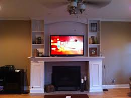 baby nursery alluring blackened stainless steel and tv cabinet over fireplace custom cabinets fireplace