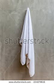 hanging white towel. Clean And White Towel Is Hanging On A Hanger With Concrete Wall In The Bathroom I
