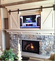 tv above mantel found the perfect design solution for hanging your above the fireplace heat cl tv above mantel decorating ideas for over fireplace