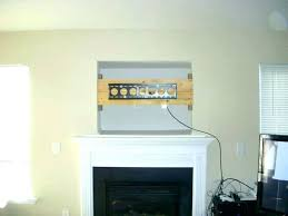 tv installation above fireplace mounted over fireplace fabulous mount fireplace fireplace mantels with mounted above cable tv installation
