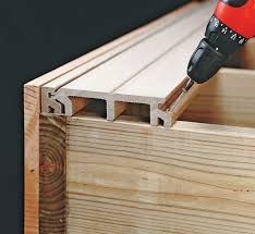 tongue and groove composite decking. Fitting The Tongue Of A Deck Board Into Starter Strip Groove On DIY And Composite Decking -