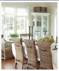 beautiful clic timeless wicker for coastal beachy style love these high back chairs teamed with all the white and the white bookcase with rattan trunk