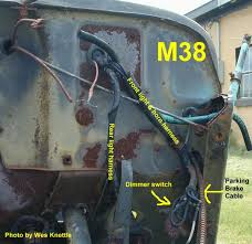 willys m jeeps forums viewtopic early wiring harness this is the late setup showing the two harness tape wrapped together until they exit the firewall through the single hole harness panel