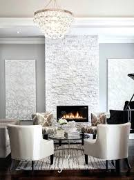 modern white fireplace abbey bling chandelier contemporary living room design like the rough tile on the
