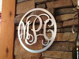 metal monograms sparkle on a wall circular frame craftcuts com