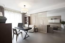home office living room modern home. beautiful modern simplistic office desk and chair in open plan home room adjoining the living a