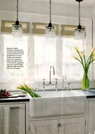 lovely mini glass chandelier kitchen pendant lighting over white kitchen cabinet and sink
