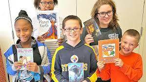Our Place donating books to various organizations | News |  newportplaintalk.com