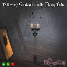 haunted house lighting. halloween candelabra with flying bats haunted house lighting a