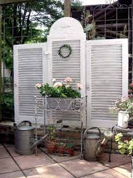 old shutters used as a privacy screen