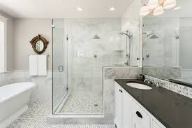 master bathroom in new luxury home bathtub and shower with tile and glass shower doors