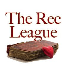 the rec league heart shaped chocolate resting on the edge of a very old book